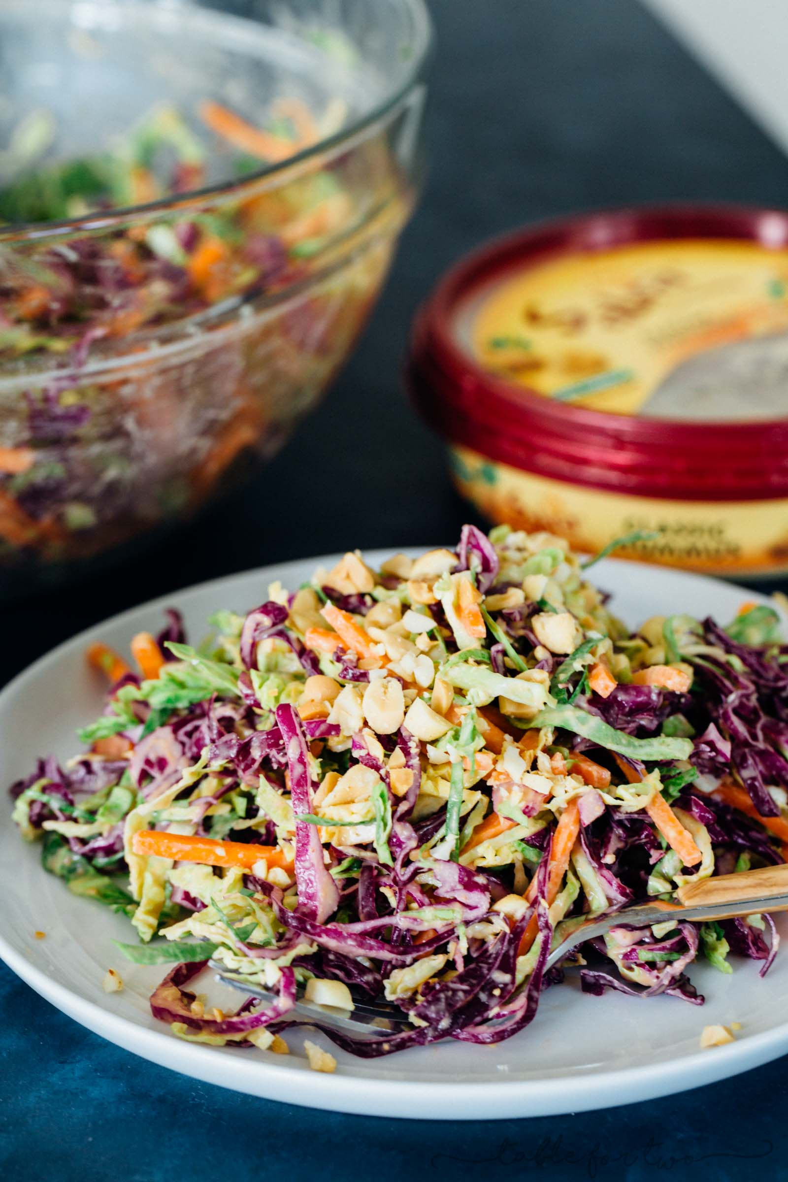 This cabbage slaw is a crisp and refreshing side dish for your next gathering! The creamy hummus dressing made with @sabradips classic hummus is going to be one of your new favorites to drizzle on everything! #ad