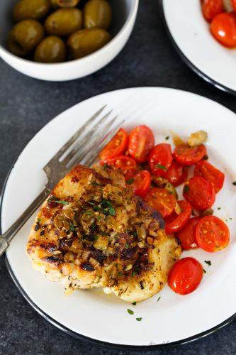 This oven-roasted chicken with olives and tomatoes is a deliciously flavorful weeknight dish. If you love briney and sweet; this roasted chicken is going to be your new favorite. The marinade is packed with flavor and is the perfect compliment to chicken!