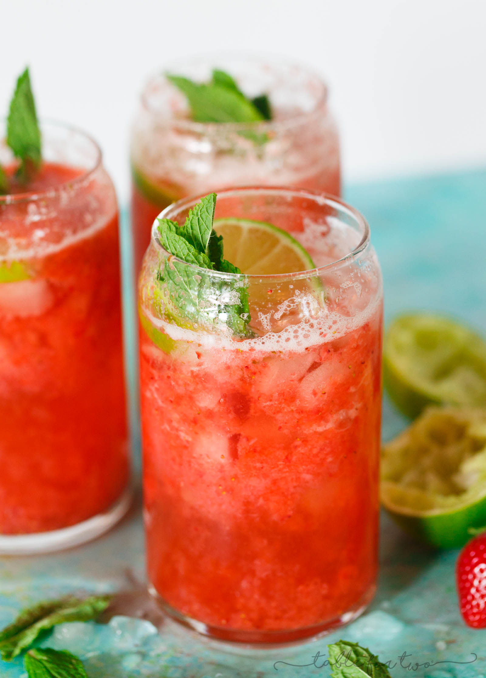 This refreshing strawberry rosé mint limeade is made with fresh seasonal ingredients! You will love sipping on this at your next outdoor party or get-together! Fresh strawberries are key and the refreshing mint and tangy lime juice rounds out the flavors of this drink perfectly! Serve with or without alcohol!