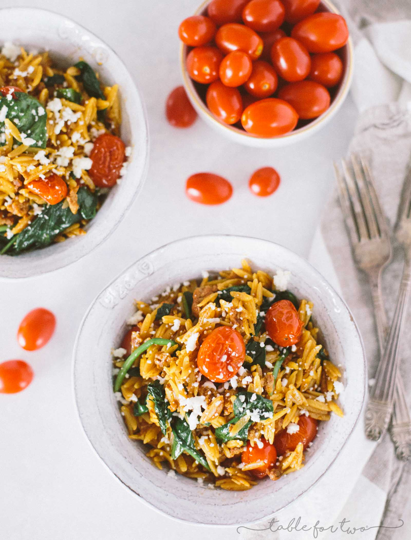 Cheesy chorizo orzo with blistered tomatoes and spinach is a quick and easy dinner with simple ingredients! Small ingredient list, LARGE flavor! You will love the flavors of this and how little effort it takes to come together!