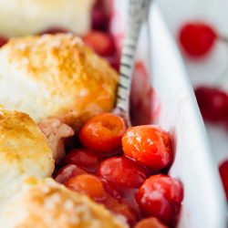 It could not be easier to make a classic sour cherry cobbler right in your own home. Using the seasonal and fresh cherries, this classic sour cherry cobbler comes together quickly and easily! Use any seasonal fruit in this recipe and top with a giant scoop of ice cream for the ultimate dessert!