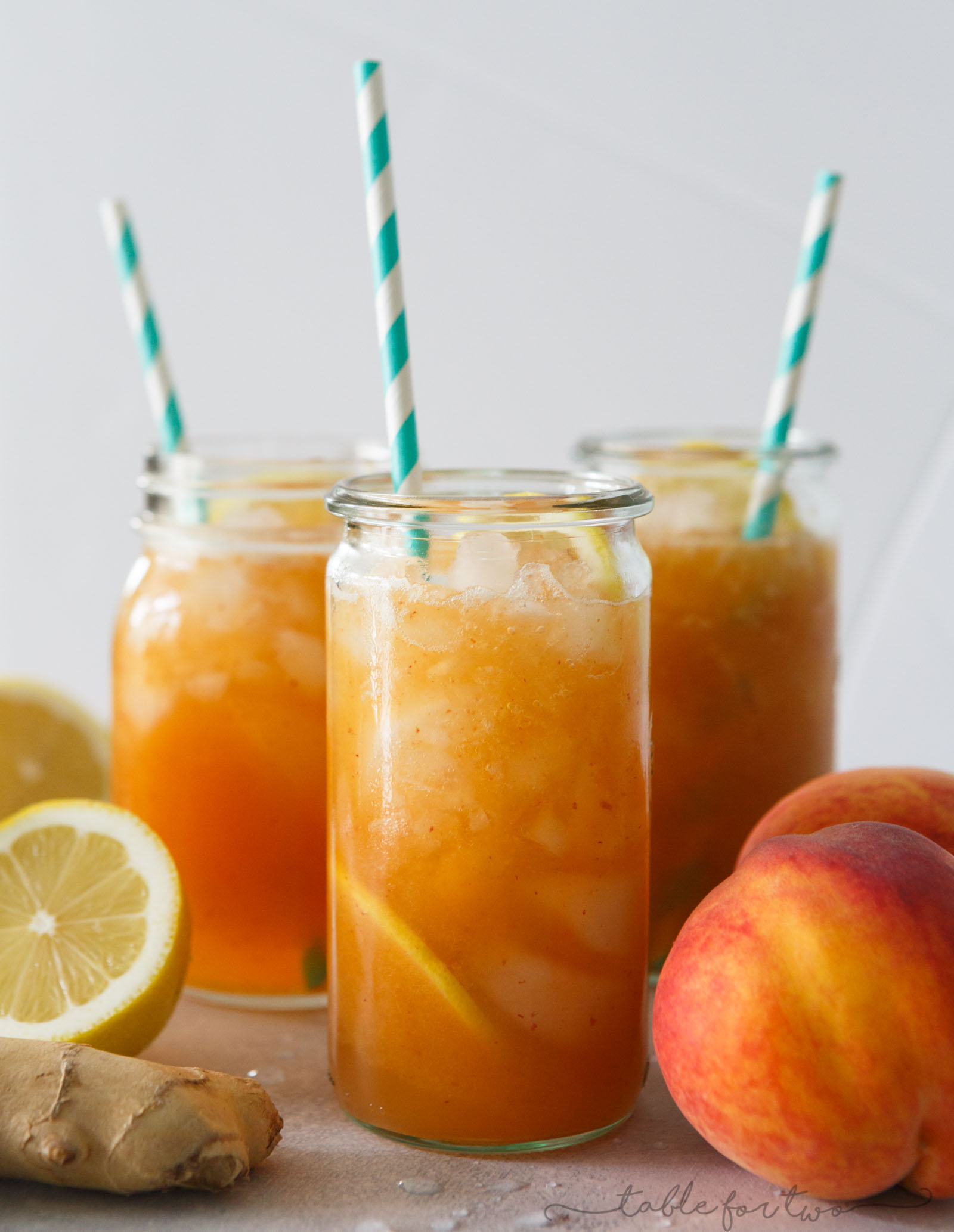 This lemon ginger peach spritzer is so fresh and refreshing that you'll be sipping on this all day! The flavors pair perfectly together and it's so easy to make with all the peaches you've picked up at the market!