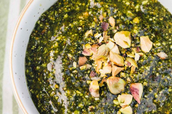 This pistachio mint pesto has so much robust flavor and is a great topping for all grilled meats, pasta, and any sort of dipping or cheese and meat platter! #pistachio #mint #pesto #grilling #pestorecipes #recipes #foodprocessor