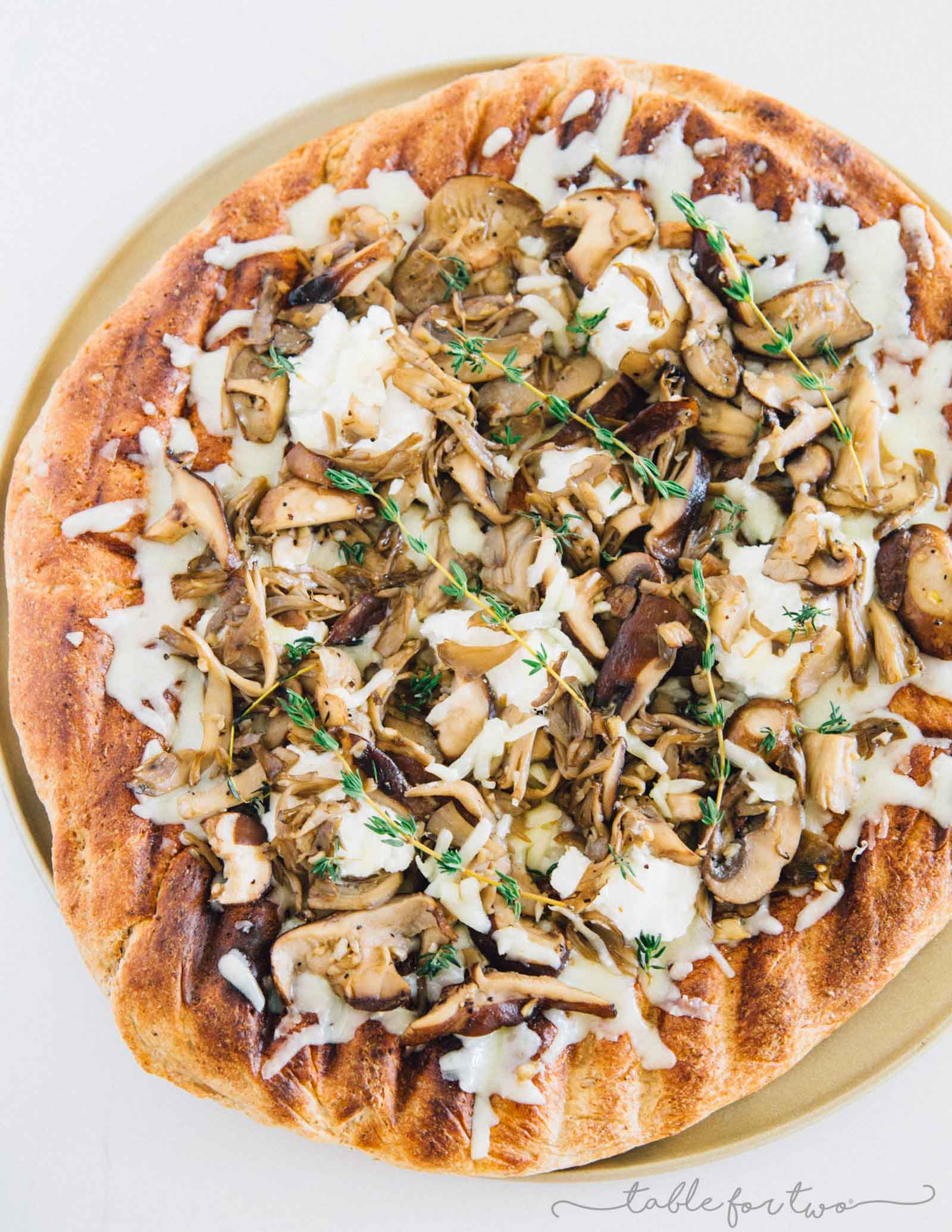 Mushroom lovers will be in paradise with this triple mushroom and herb grilled pizza! The earthy and hearty mushrooms on top of this pizza pair perfectly with the creamy ricotta and mozzarella cheese!