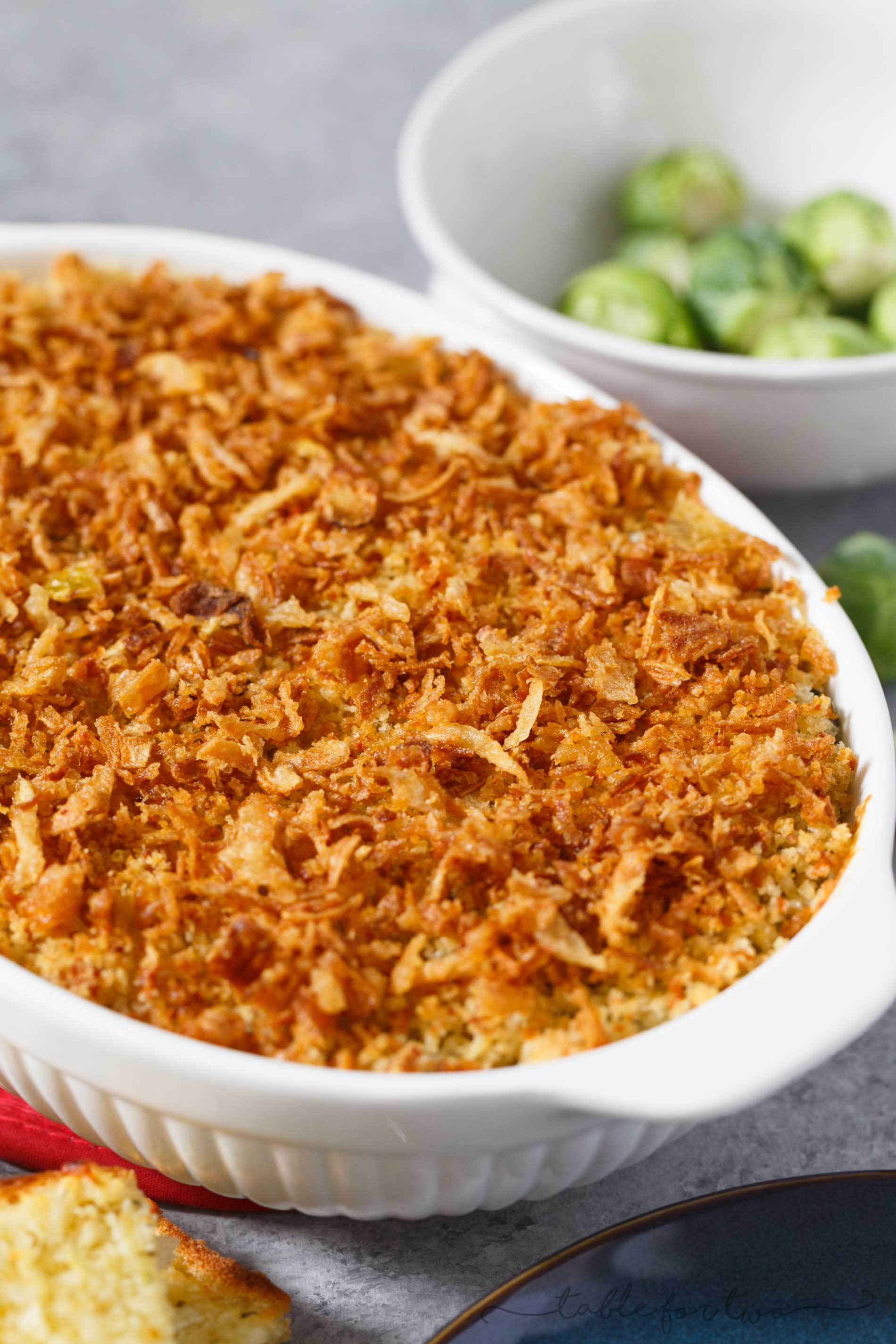 Pretty sure if you hate brussels sprouts, you haven't had them the right way. This roasted brussels sprouts gratin with garlic crumble and fried onion topping is going to elevate your side dish game at any party or potluck AND you will fall in love with brussels sprouts all over again! PROMISE!