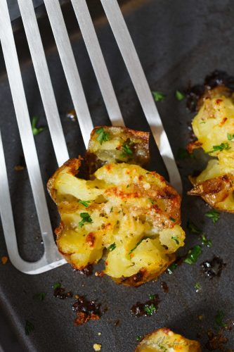 Smashed potatoes are a great alternative to mashed potatoes! These smashed potatoes are topped with a garlic ranch butter then parmesan cheese is sprinkled on top! SO GOOD!!