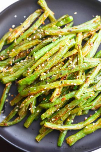 These garlic roasted green beans are the perfect side dish addition to any table and meal! They will convert you to love green beans if you don't already!