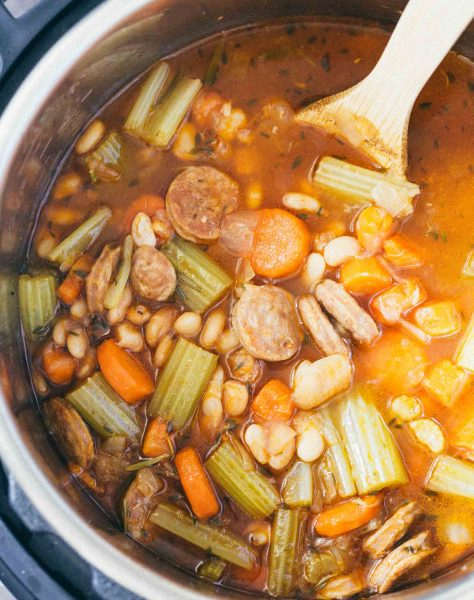 A deliciously flavorful herbed white bean and sausage soup that requires no beans to be soaked! This will be a new Instant Pot favorite!