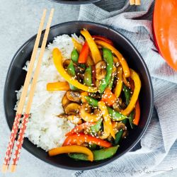 If you're in a dinner rut and need a quick and flavorful dinner idea, this 20-minute vegetable stir fry has got it all! Super easy to prep ahead of time, too! #stirfry #vegetablestirfry #vegetables #veggiestirfry #quickdinner