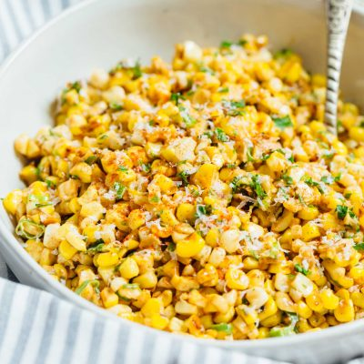 A less messy way to eat Mexican street corn! This Mexican street corn off the cob is one you'll want to make for all your parties year-round! #mexicanstreetcorn #corn #mexican #sidedish #cornrecipe