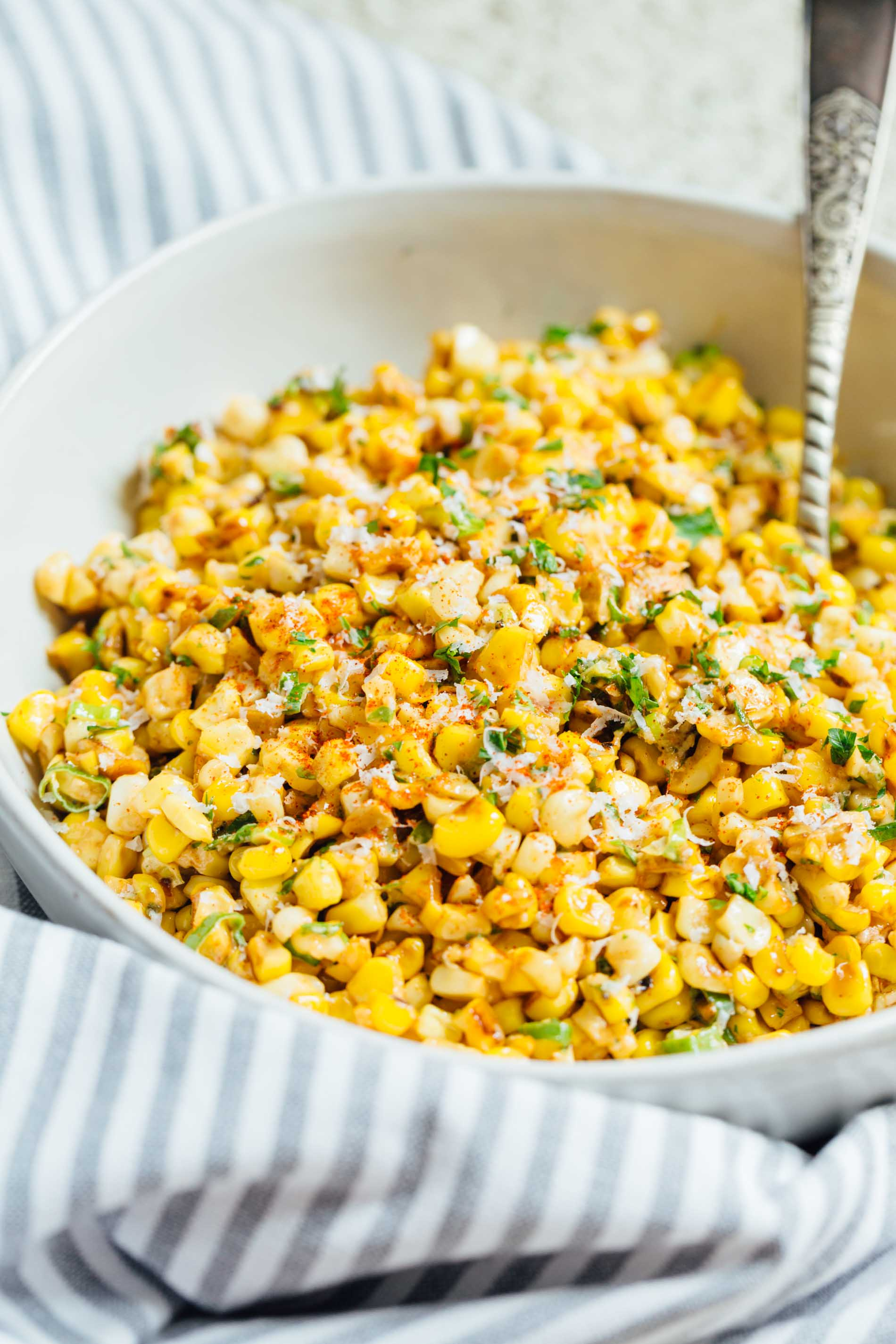 A less messy way to eat Mexican street corn! This Mexican street corn off the cob is one you'll want to make for all your parties year-round!