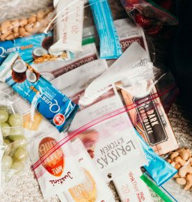 Tips and tricks on how not to be a hangry traveler and what smart snacks to pack in your carry-on! Why all snacks are NOT the same and why you need to pack balanced snacks to curb hunger! #travel #travelsnacks #savvytraveler #smarttravel #snacks