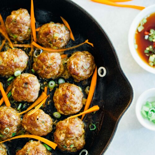 These Asian pork meatballs have a lot of flavor and are perfect topped on rice noodles or a bowl of rice! They are great for party appetizers too! #porkmeatballs #asianmeatballs #meatballrecipe