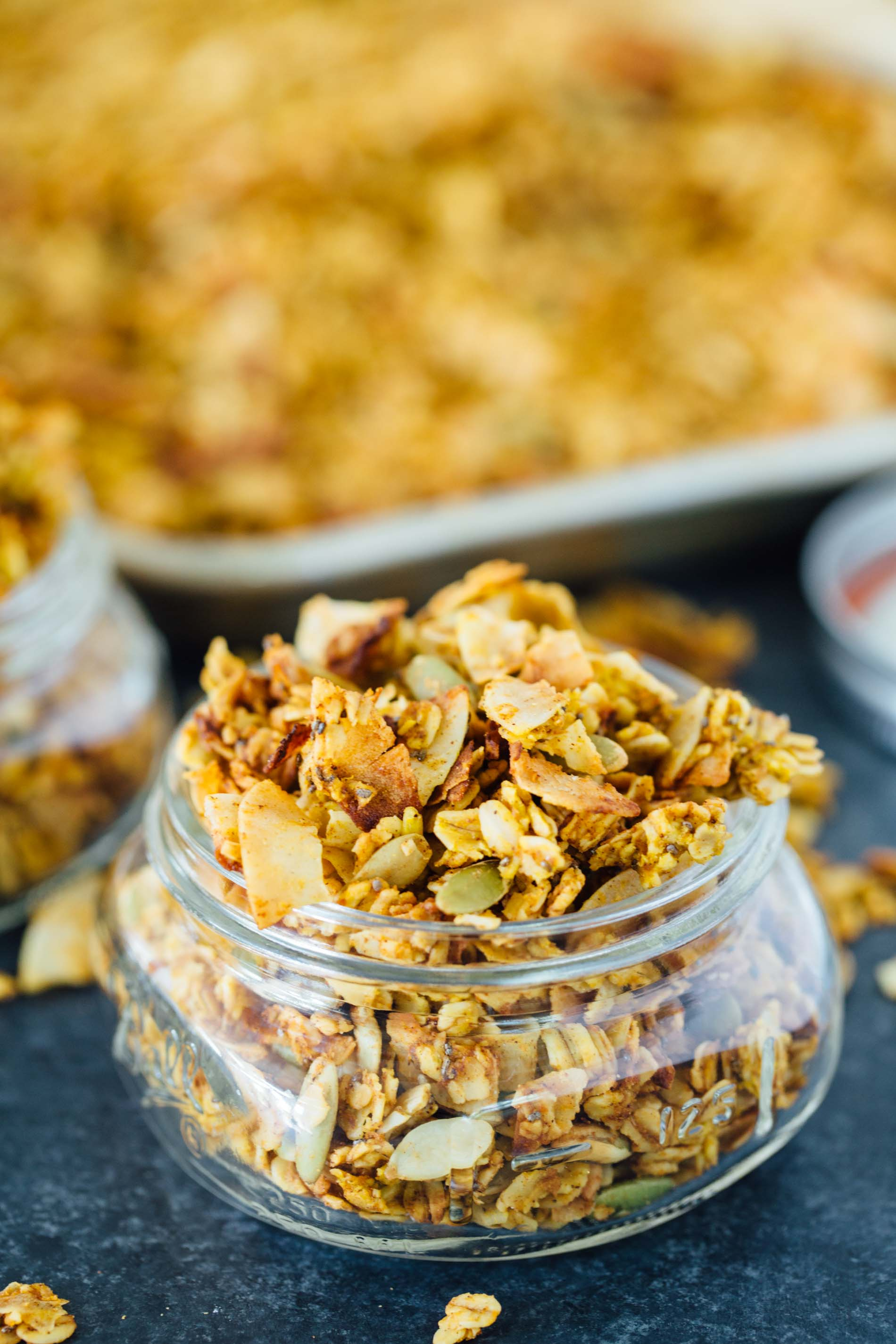 This pumpkin coconut granola has all the flavors of Fall in this sweet and salty combination! It's perfect to top on plain yogurt, oats, or even with milk!