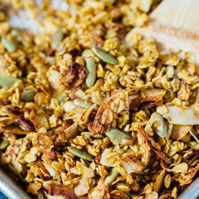 This pumpkin coconut granola has all the flavors of Fall in this sweet and salty combination! It's perfect to top on plain yogurt, oats, or even with milk! #granola #pumpkincoconut #coconut #pumpkinrecipe #granolarecipe