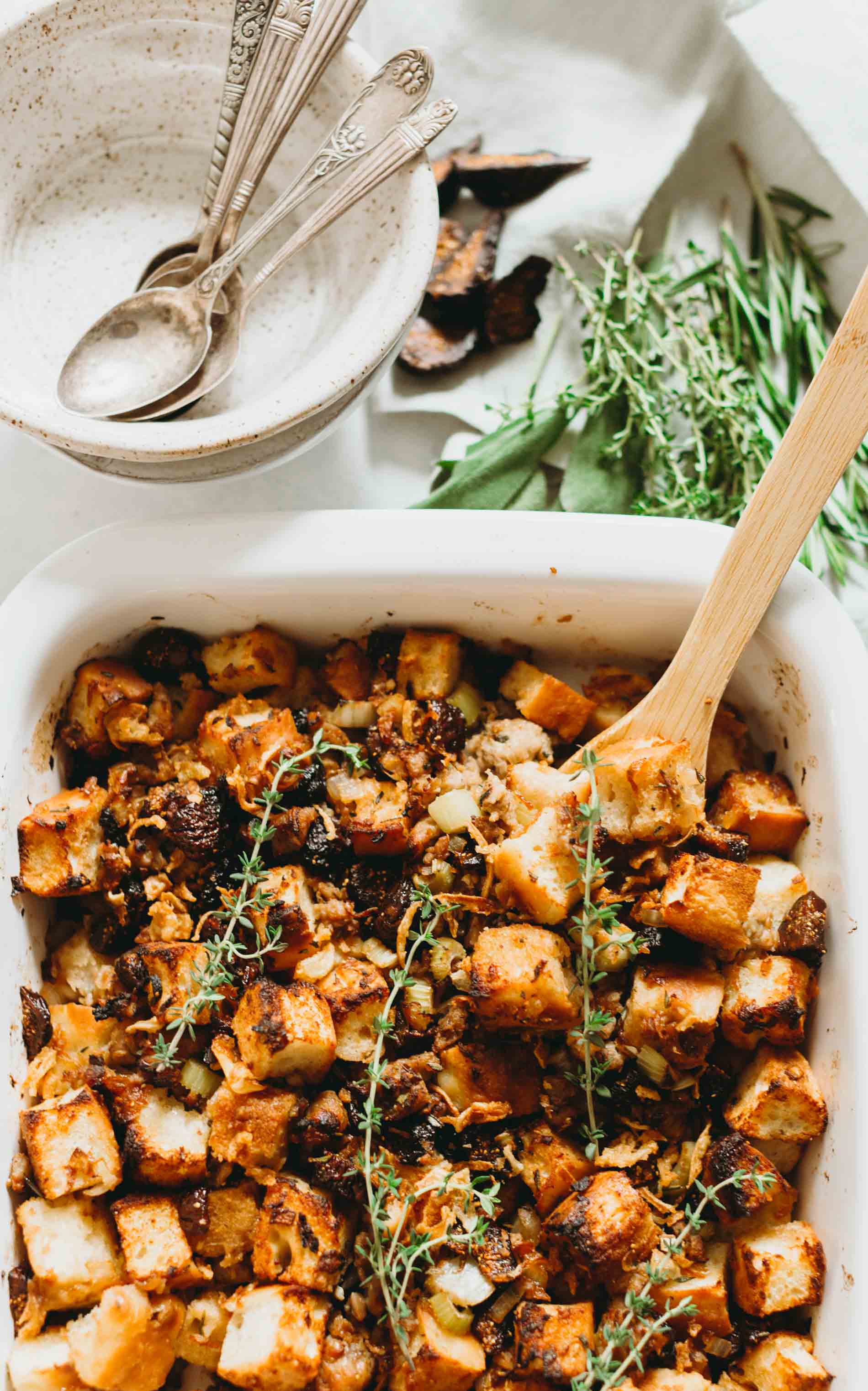 A unique take on the traditional Thanksgiving stuffing! This focaccia stuffing is filled with dried figs and chicken sausage for sweet and savory flavors! #thanksgiving #sidedishes #thanksgivingrecipes #stuffing #stuffingrecipe #focaccia #sausage #fig