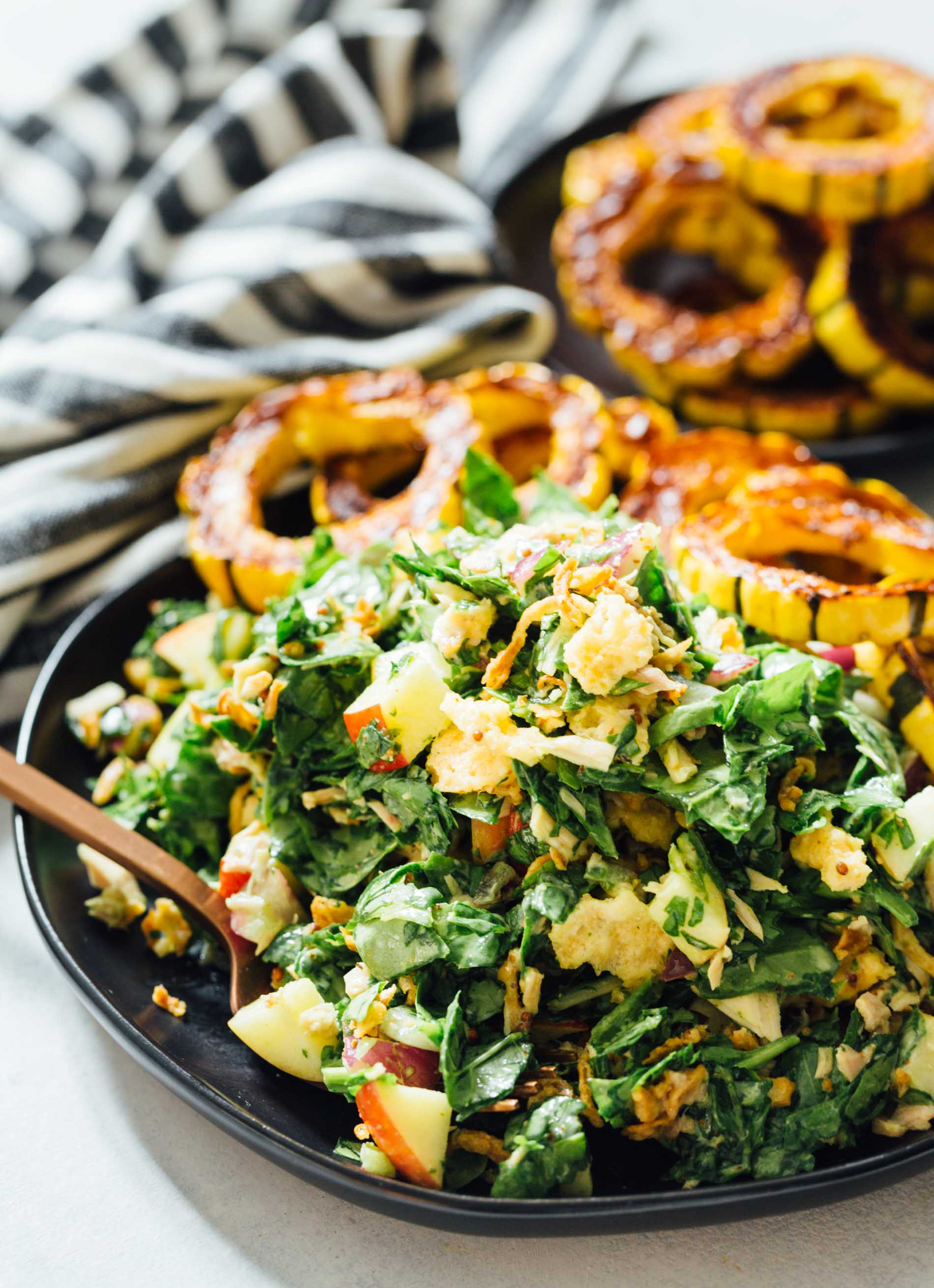 A spinach tuna salad topped with roasted delicata squash is a heavenly combination! The delicata squash gives it a unique yet distinct sweetness but it also adds volume to make this salad hearty and filling!