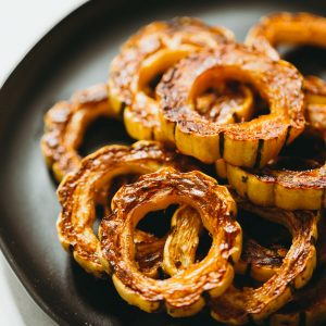 Delicata squash is an easy side dish to make and incredibly sweet like candy! If you've never had it before, now is your time to try this unique and delicious squash! #squash #delicatasquash #squashrecipe #roastedsquash