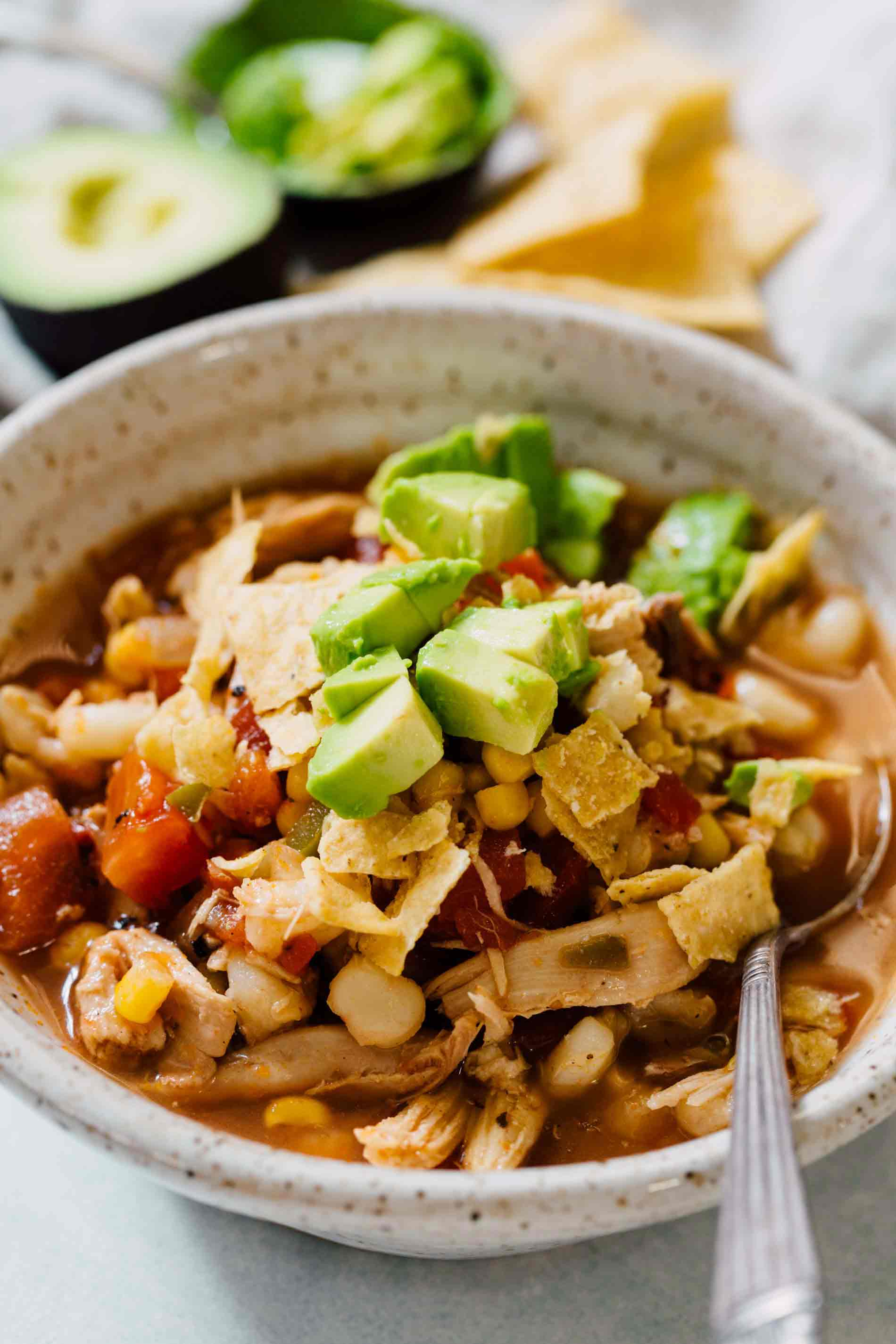 This chicken tortilla soup made on the stovetop is deliciously flavorful and spicy! You'll love how quickly it comes together and all the textures throughout the soup! The broth is SO good you'll be going back for more bowls!