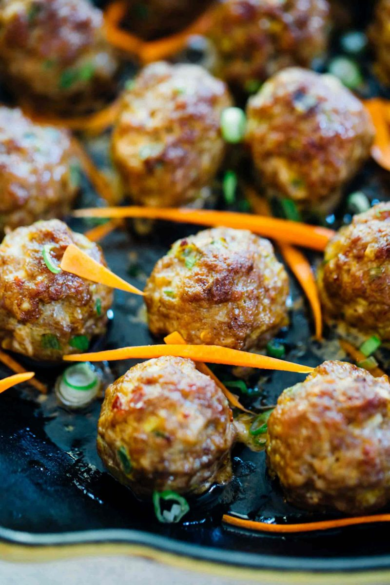 These Asian pork meatballs have a lot of flavor and are perfect topped on rice noodles or a bowl of rice! They are great for party appetizers too!
