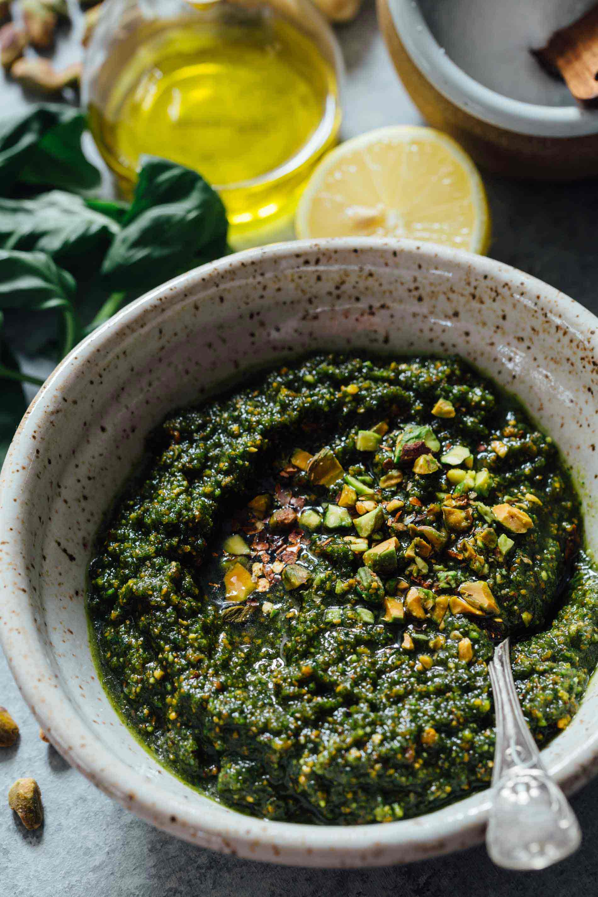 If you need to elevate a rather boring dish, put some pistachio pesto on it and you will instantly elevate a dish! It's versatile enough to use on various meats, pastas, and more! #pistachio #pistachiorecipe #pistachiopesto #pestorecipe