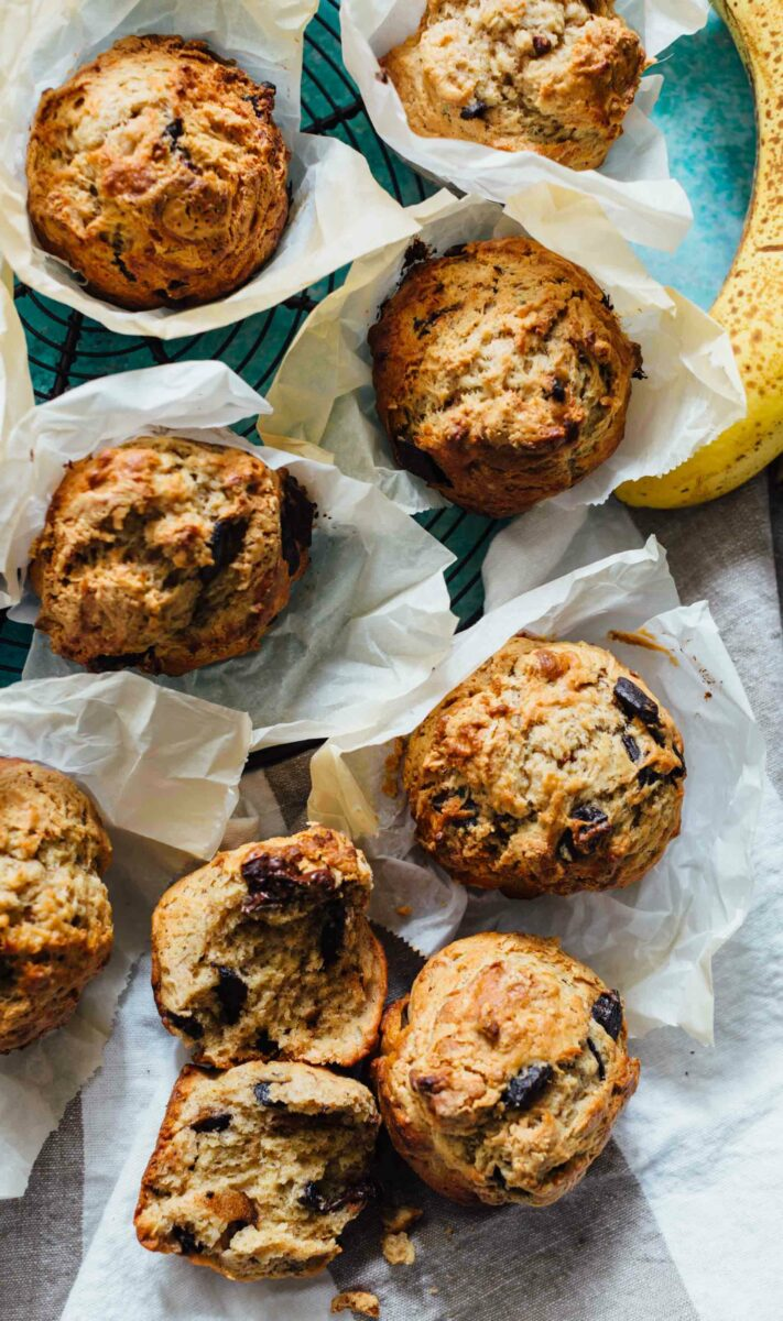 These peanut butter and chocolate banana muffins are so soft and tender with the biggest domed top! They're just like straight out of a bakery!
