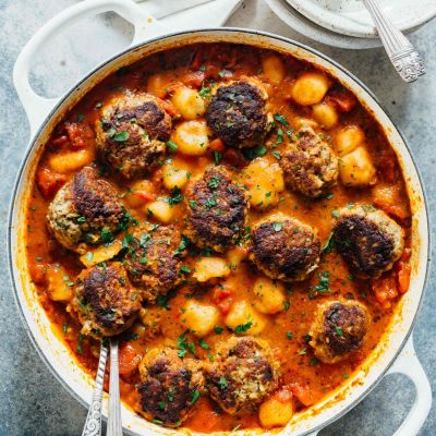 Cauliflower gnocchi and meatballs is a cozy alternative to the classic spaghetti and meatballs. All made in one-skillet! Who can complain?!