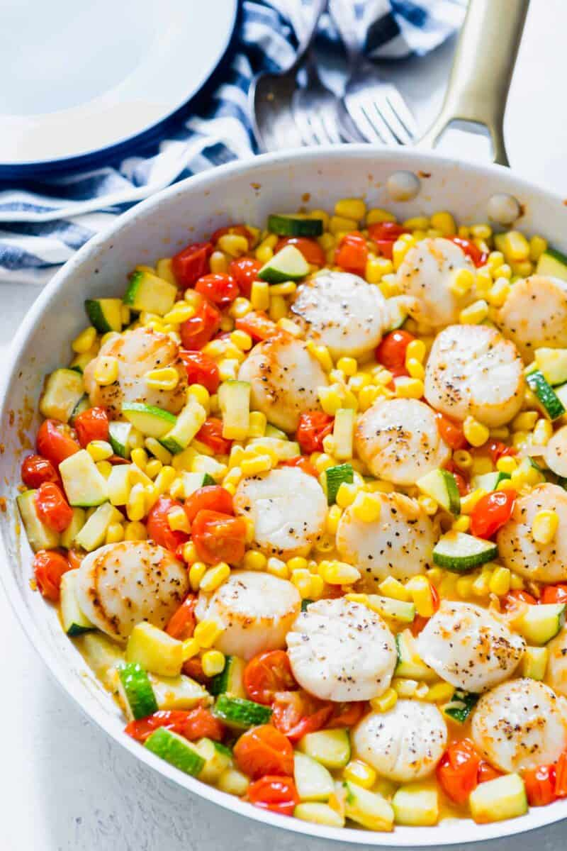 Scallops and summer vegetables make for a quick weeknight meal! Everything comes together super quickly and it's a light and refreshing meal option!