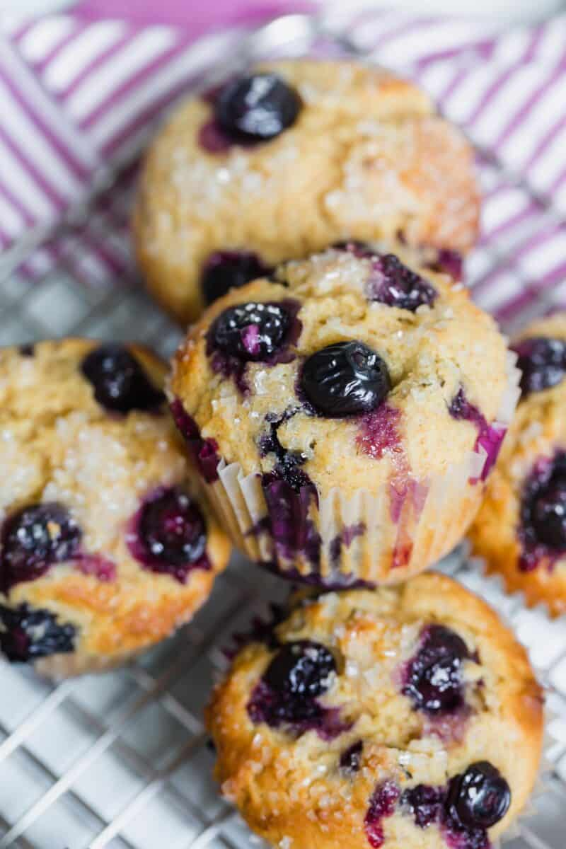These tender blueberry overload muffins are literally overflowing and FILLED with fresh blueberries! They're so soft, tender, and just like straight out of a bakery!
