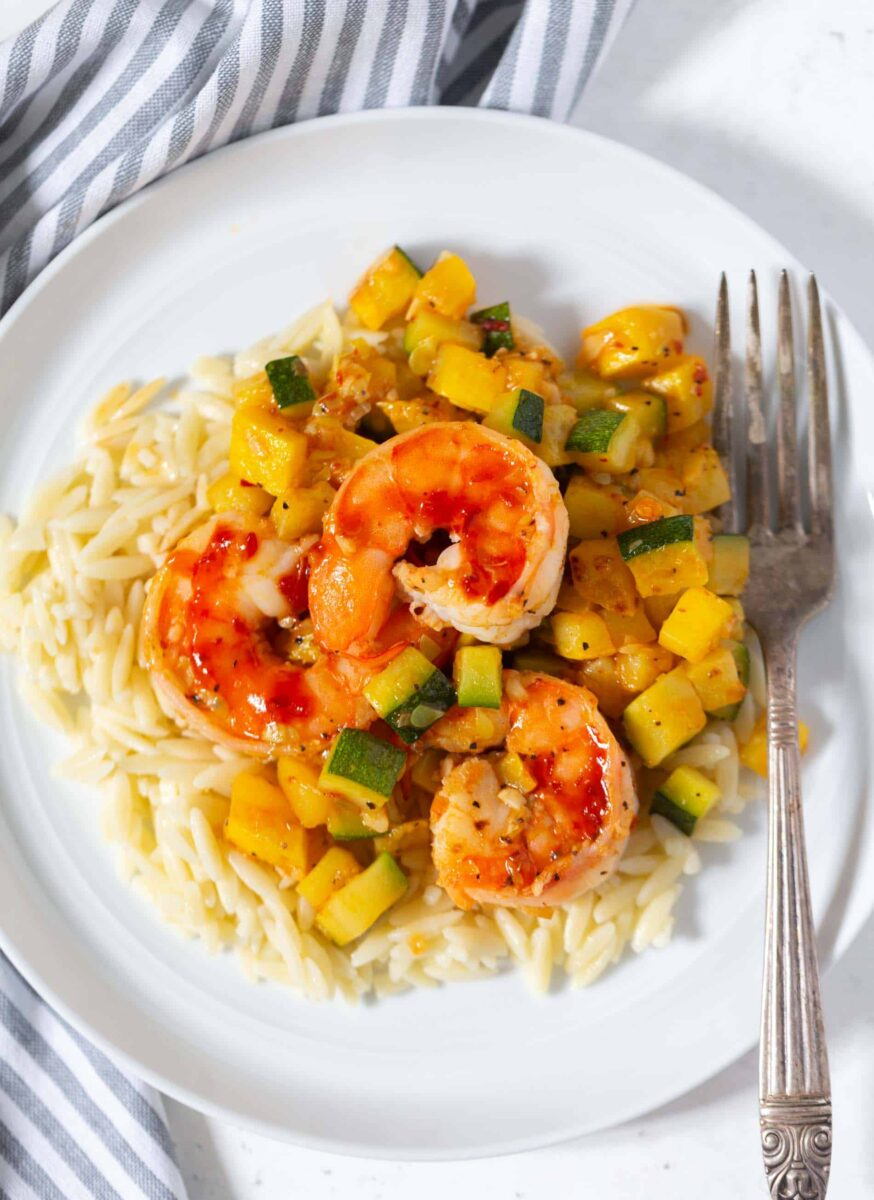 A quick and easy weeknight dinner that features shrimp, zucchini, and orzo! These ingredients are perfect together!