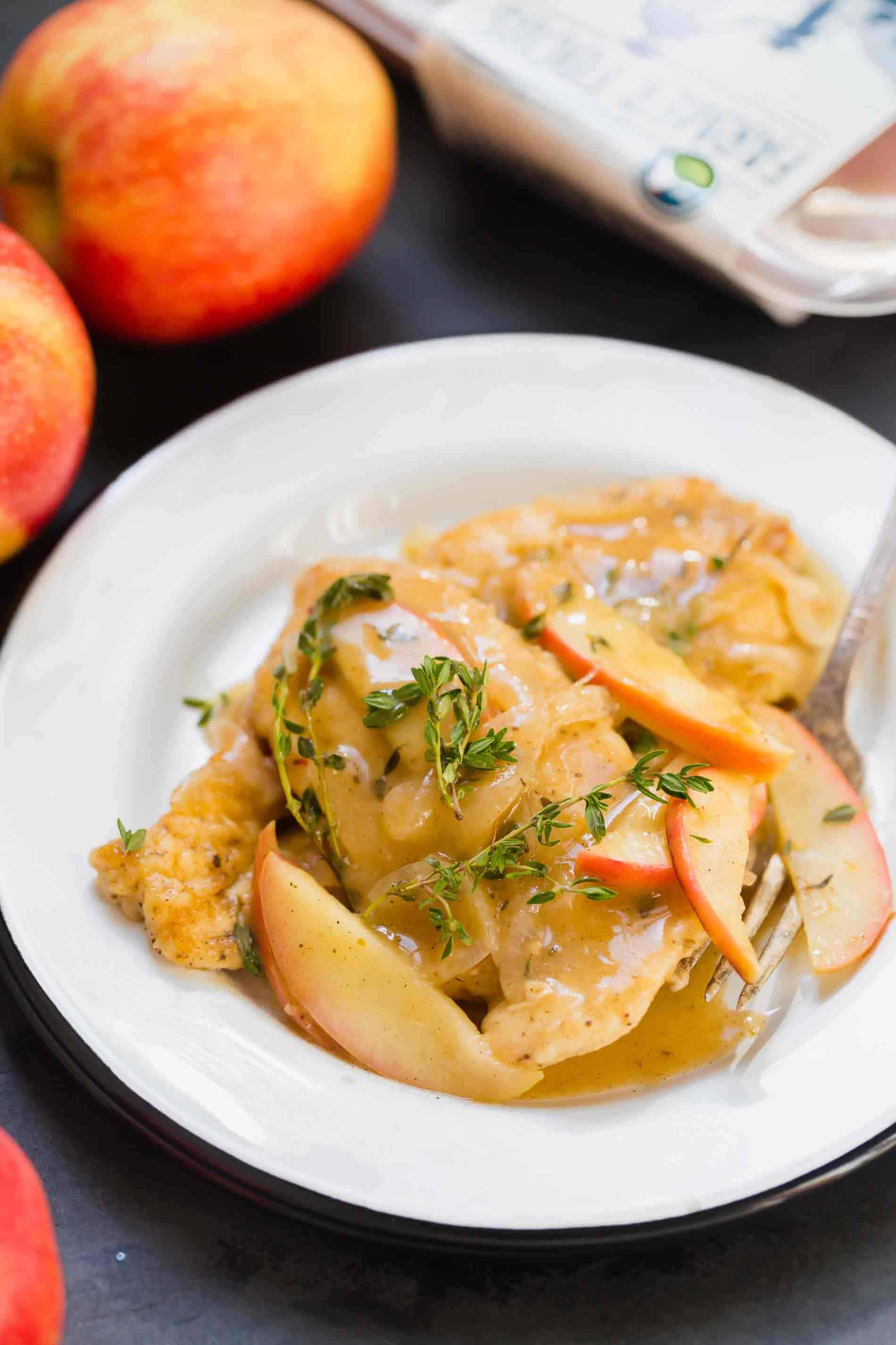 Apple cider chicken skillet served on white plate