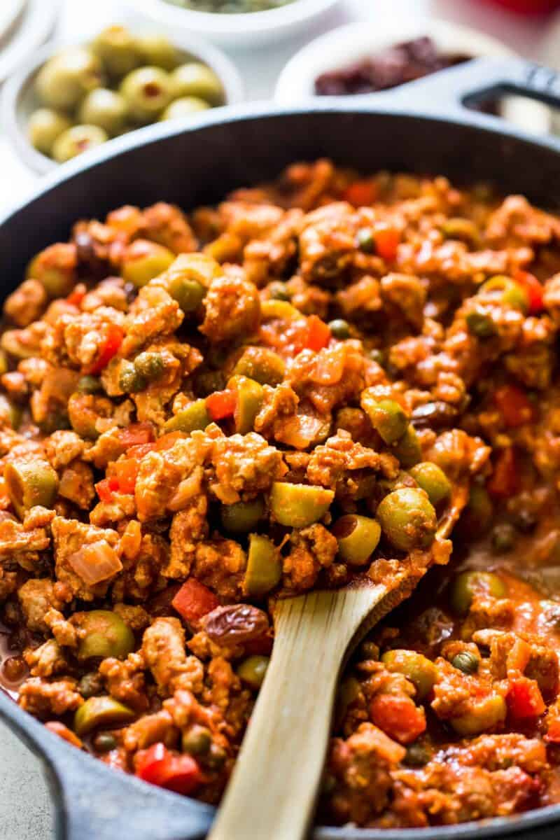 This turkey picadillo recipe is a quick and flavorful weeknight meal! Full of salty, briny, and sweet flavors!