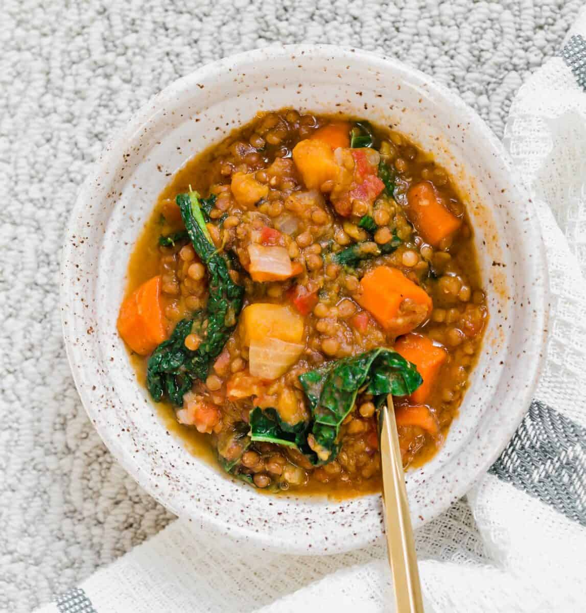 A quick lentil soup made in the Instant Pot and loaded with veggies for a deliciously cozy soup for any time of year!