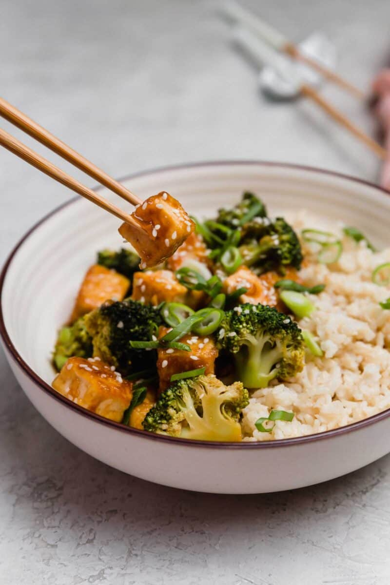 Teriyaki tofu and broccoli bowls are a great plant-based dinner idea for any night of the week! The flavors are bold and you won't miss the meat!