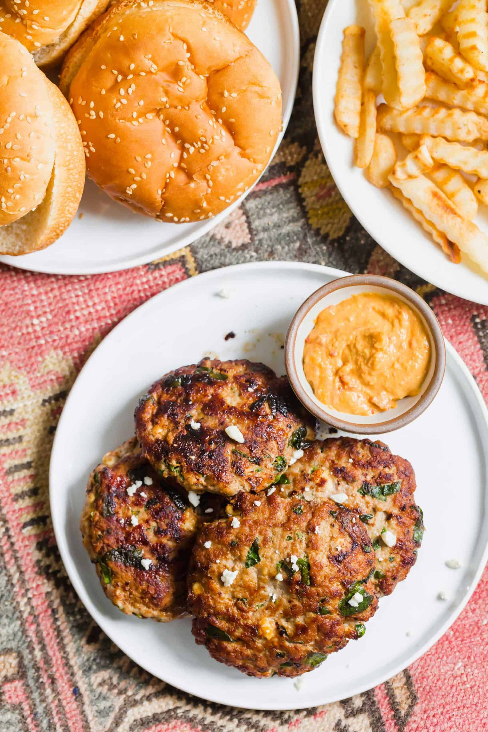 Turkey spinach and feta burgers are an excellent way to use up ground turkey in a flavorful Mediterranean-style burger! These egg-free burger patties are the perfect grilling season recipe!