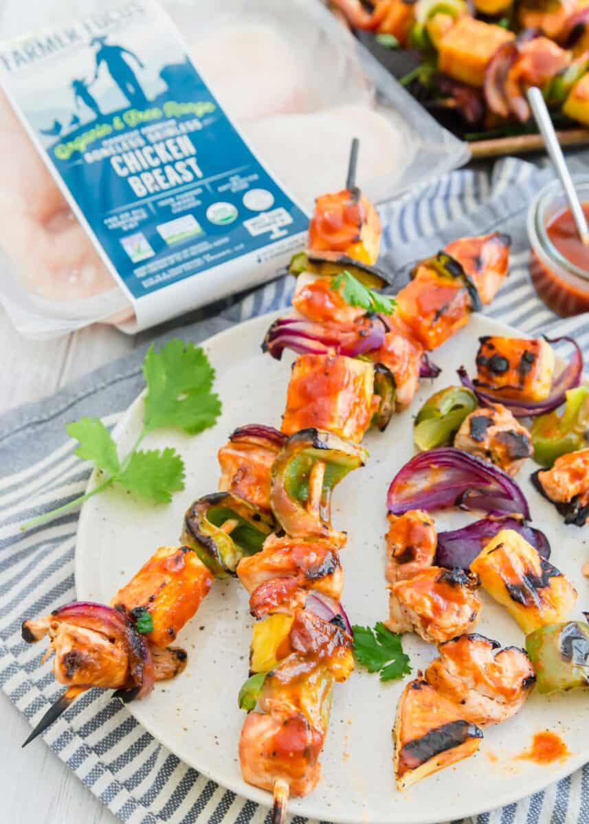 Grilled pineapple bbq chicken kabobs are the perfect summer grilling meal! A deliciously sweet and tangy BBQ sauce is slathered all over these chicken kabobs!