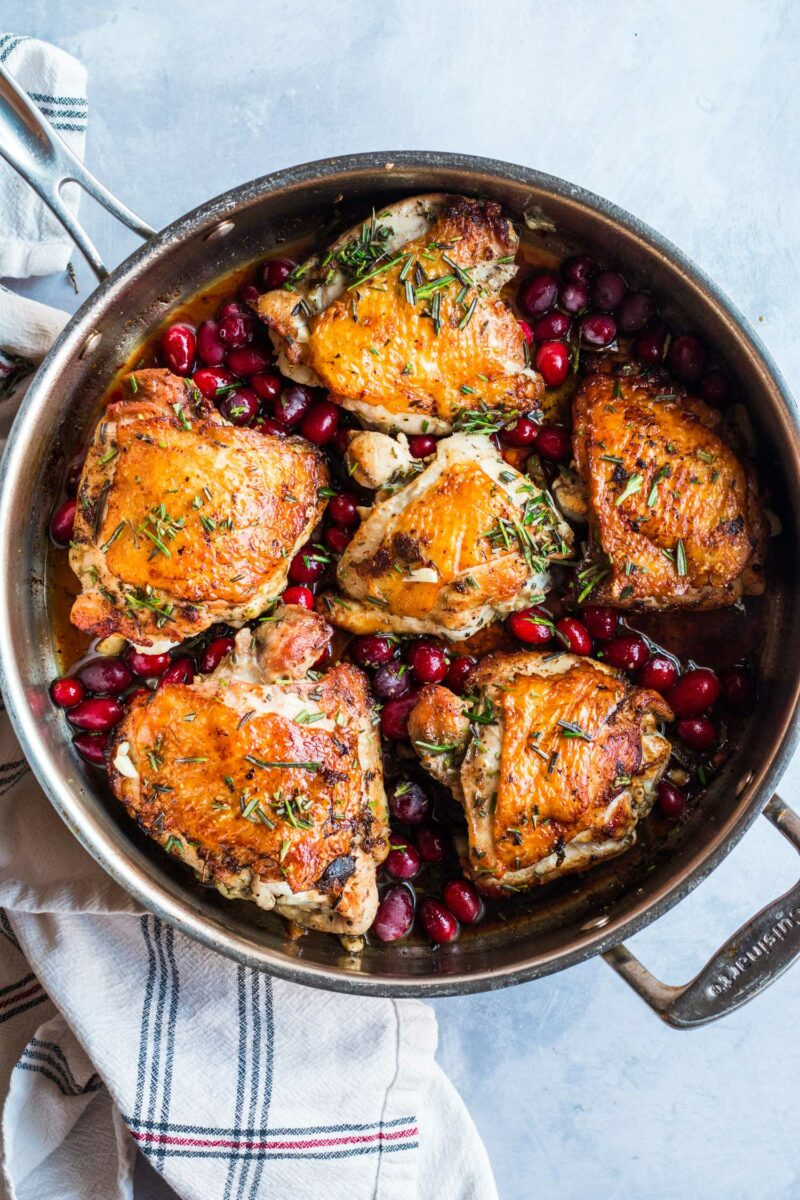Herbed cranberry chicken is an elegant dish that can be served for a dinner party and/or for a date night in! Minimal effort but loads of earthy flavor!