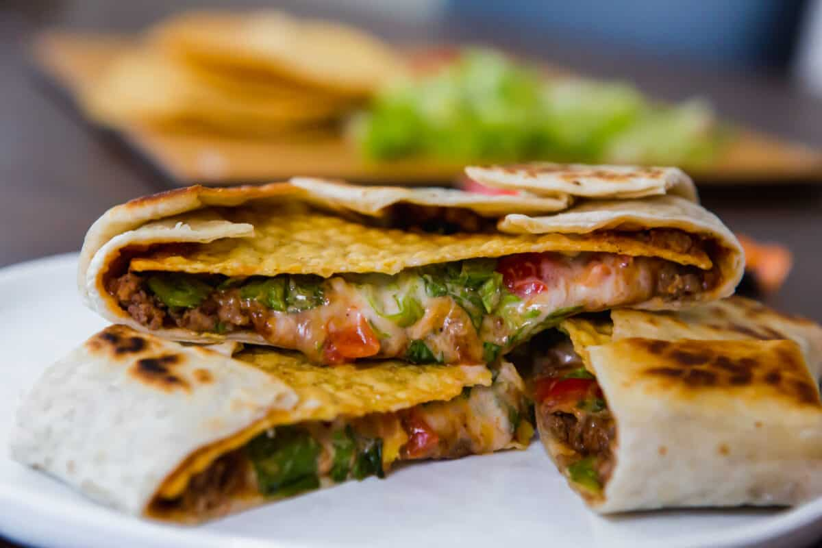 This homemade Crunchwrap Supreme recipe is going to satisfy all your Taco Bell cravings! It's filled with meaty, cheesy, crunchy goodness!