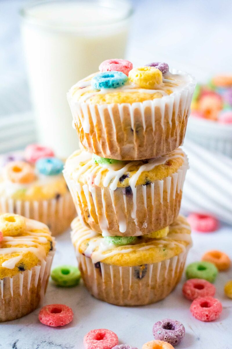 Three fruity muffins are stacked on top of each other.