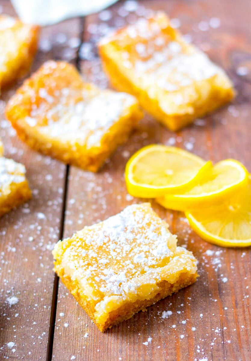 Pieces of buttery lemon cake are sprinkled with powdered sugar.