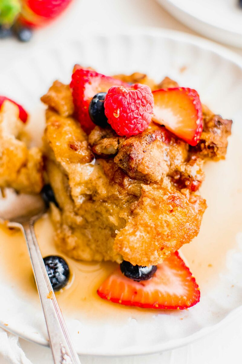 Berries sit atop a serving of breakfast casserole.