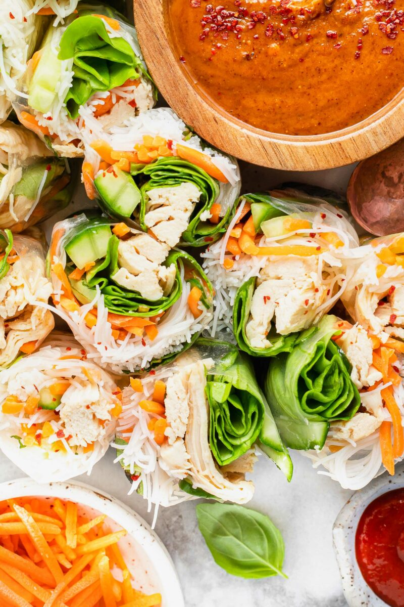 Chicken summer rolls are stuffed with vegetables and noodles.