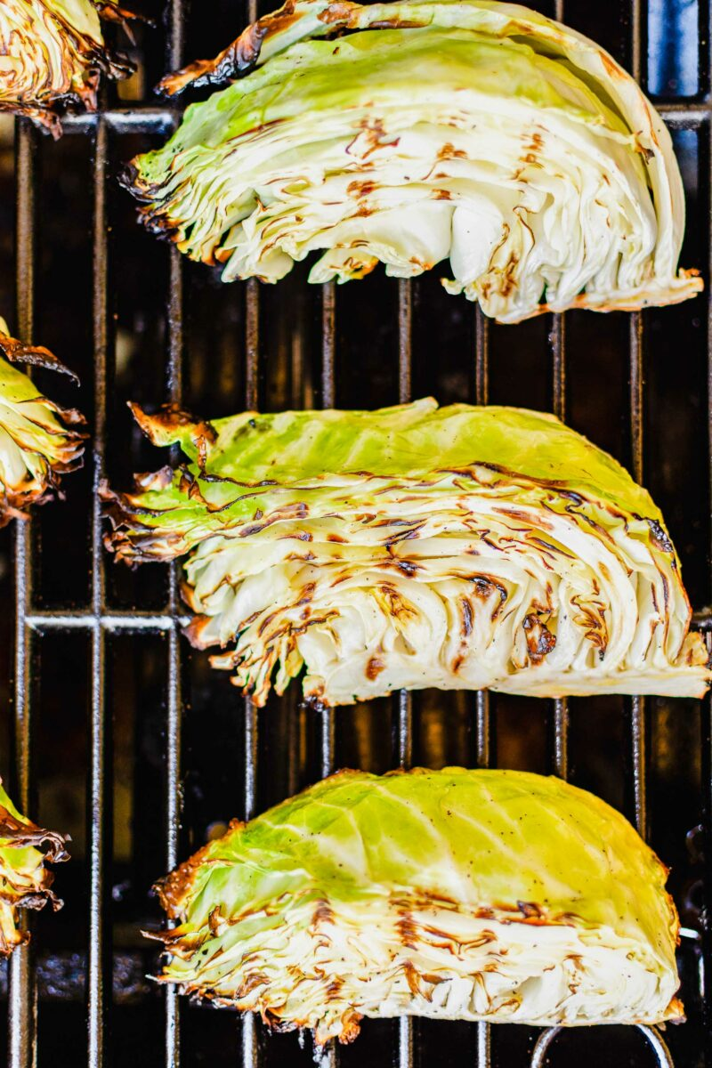 Cabbage wedges are being grilled.