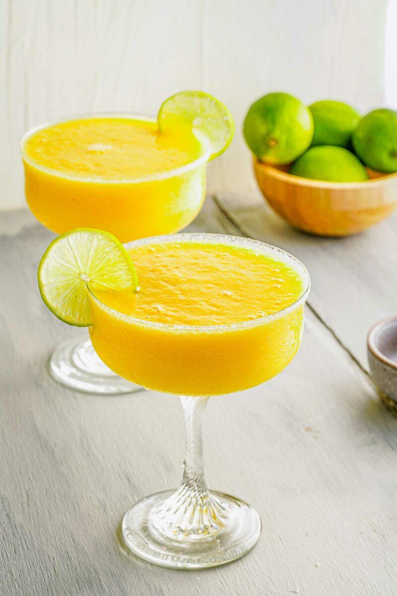 Limes garnish glasses of frozen margaritas.