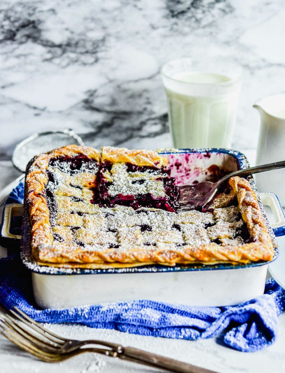 A spatula is lifting a piece of pie from the baking dish.