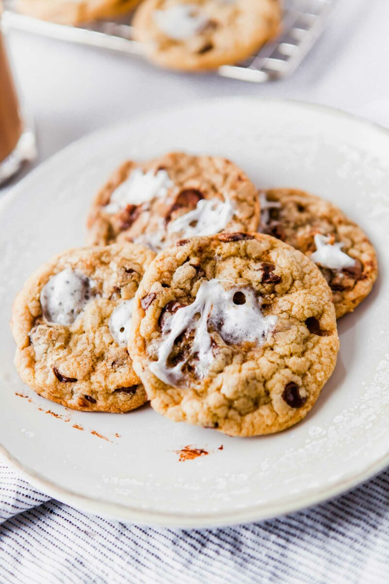 Several cookies are on a white plate.