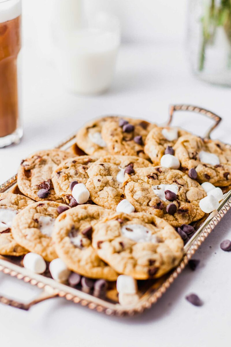 A dozen cookies are presented on a serving tray.