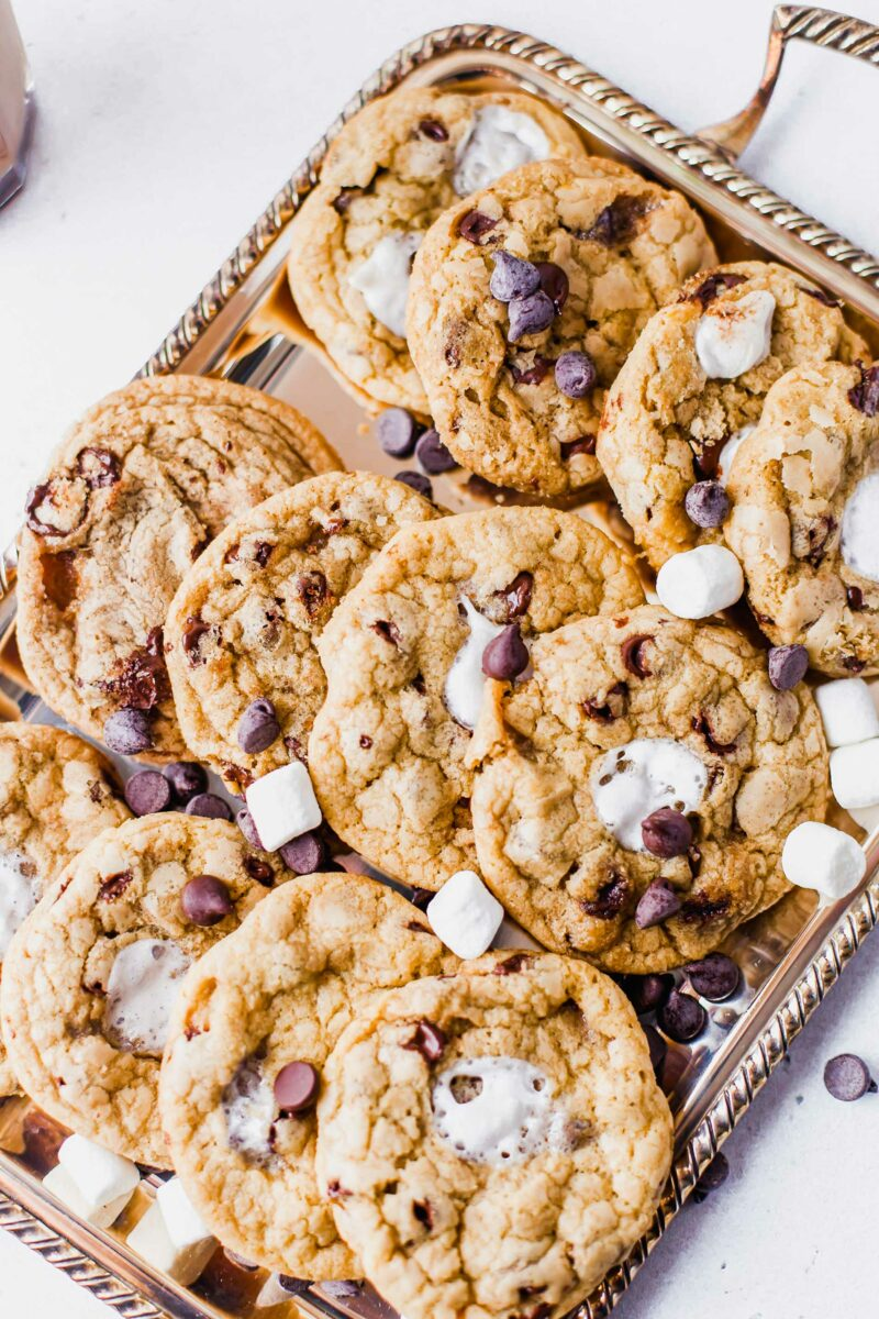 A metal platter is holding a batch of s'mores cookies.