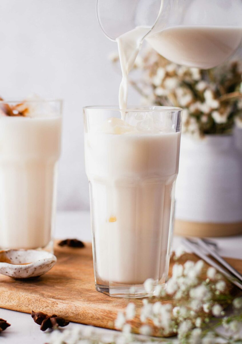 Horchata is being poured into a glass.