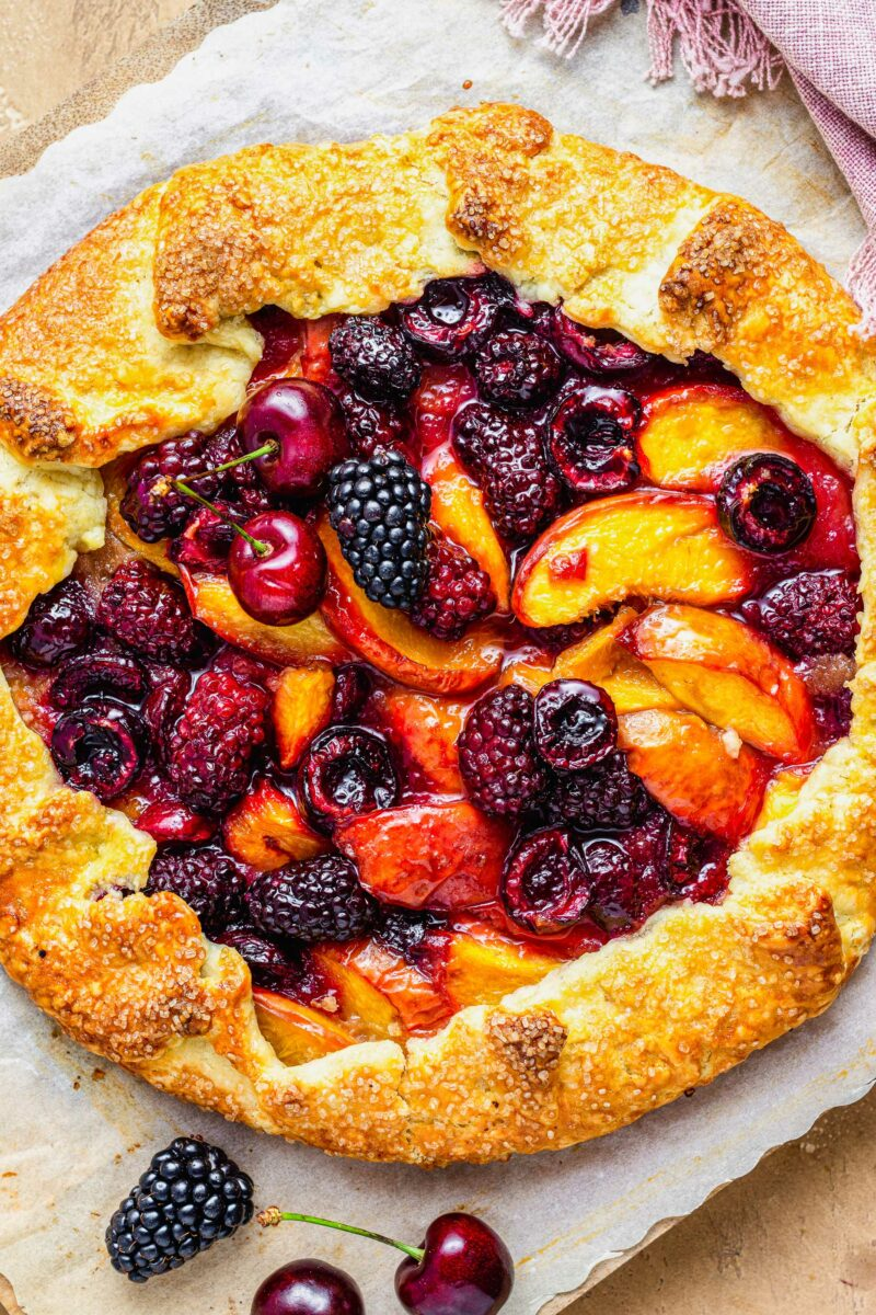 Stone fruits are baked into the center of a galette.